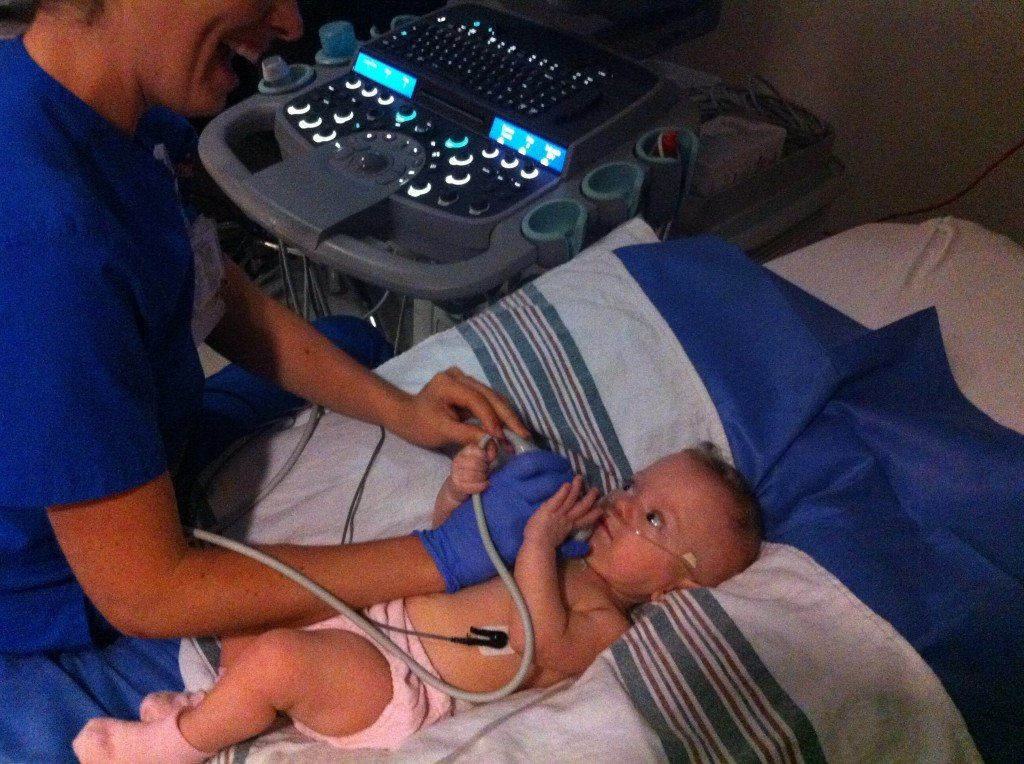 Coraline assisting in her own echo-cardiogram. I'm sure the tech appreciated it.